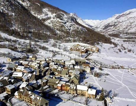 Chalets in Serre Chevalier and hotels in Serre Chevalier - the village of Villeneuve with Club Med in the background