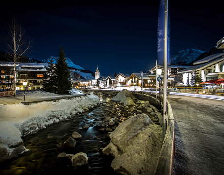 Lech centre at night with chalets and hotels