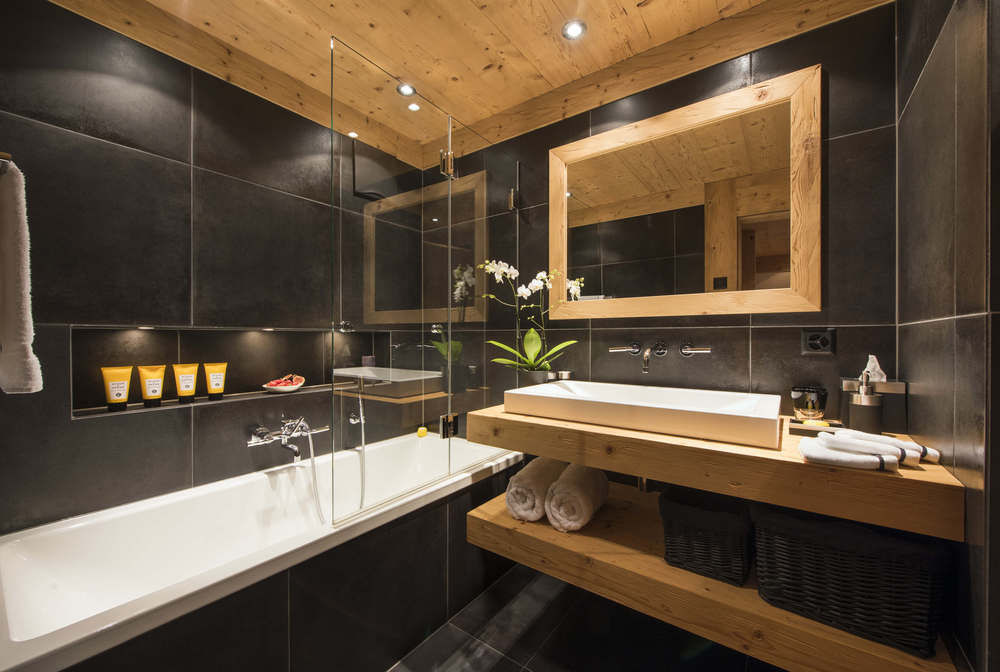 A smart en-suite bathroom in the Chalet White Ace, Gstaad
